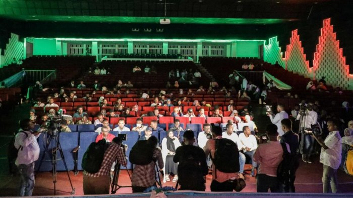 Viewers wait for the first screening of Somali films at The Somali National Theatre in Mogadishu, on September 22, 2021, which has been opened for the first time to public after its inauguration in 2020. Credit: AFP Photo