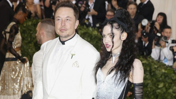 """Elon Musk and Grimes arrive at the Metropolitan Museum of Art Costume Institute Gala (Met Gala) to celebrate the opening of """"Heavenly Bodies: Fashion and the Catholic Imagination"""" in the Manhattan borough of New York. Credit: Reuters File Photo"""