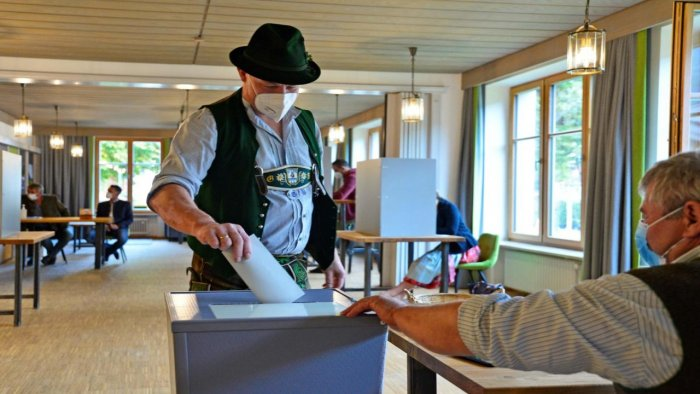 A casts his ballot at a polling station during general elections in Bayrischzell, southern Germany. Credit: AFP Photo