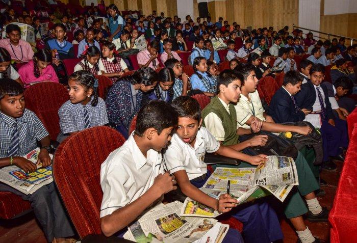 Students reading Prajavani news paper during Prajavani Quiz Championship, at Senate Bhavan in Mysuru on Monday January 08, 2018.- PHOTO / IRSHAD MAHAMMAD