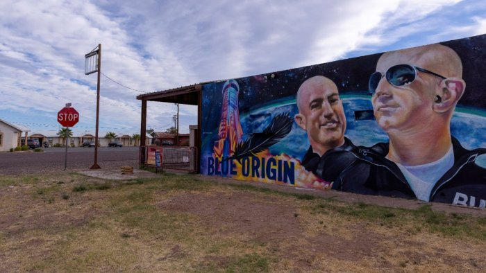 """A mural of billionaire Jeff Bezos and his space company Blue Origin adorns the side of an empty building a day before his company will send """"Star Trek"""" actor William Shatner into space from the company's facilities in Van Horn, Texas. Credit: Reuters Photo"""