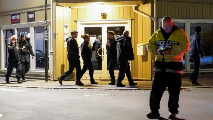 Police officers investigate at the scene where an arrow shot into a wall after several people were killed and others were injured by a man using a bow and arrows to carry out attacks, in Kongsberg. Credit: Reuters Photo