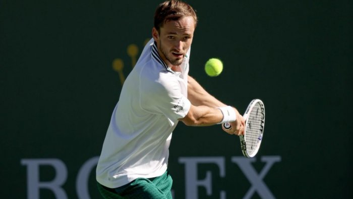 :Daniil Medvedev of Russia returns a shot to Grigor Dimitrov of Bulgaria during the BNP Paribas Open at the Indian Wells Tennis Garden. Credit: AFP Photo