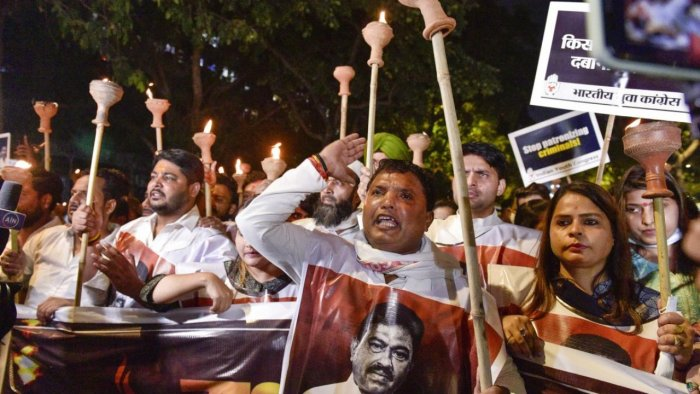 Indian Youth Congress (IYC) activists carry out 'Mashal Aakrosh Julus' from IYC headquarters to Jantar Mantar, demanding justice for the Lakhimpur Kheri violence victims and suspension of Union MoS for Home Affairs Ajay Kumar Mishra, in New Delhi. Credit: PTI Photo