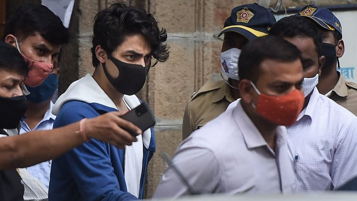Bollywood actor Shahrukh Khan's son Aryan Khan being taken to Arthur Road jail from Narcotics Control Bureau (NCB) office after being arrested in connection with the alleged seizure of banned drugs from a cruise ship, in Mumbai. Credit: PTI Photo