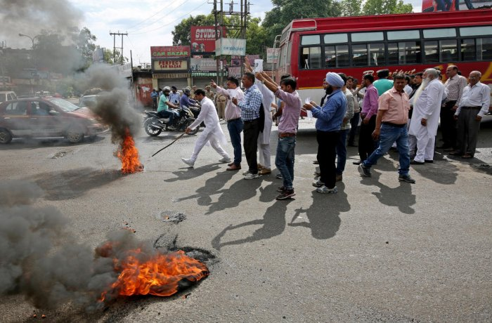 Activists of National Panther party burn tyres and shout slogans during a protest in support of various demands, including a CBI probe into the rape and murder of an eight-year-old girl in Kathua on January, Jammu April 11, 2018. REUTERS