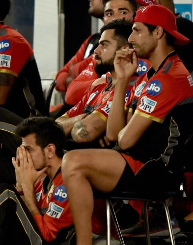 ALL GLOOM The RCB dug-out presents a picture of dejection after their defeat against Sunrisers Hyderabad on Monday. PTI