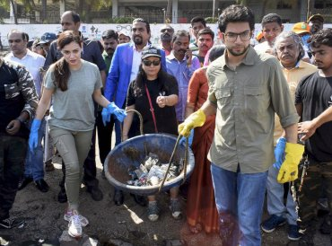 Bollywwod actress Dia Mirza and Yuva Sena Chief Aditya Thackery take part in a Beach Clean up and Tree Plantation at Dadar Chowpatty on the occasion of World Earth Day, in Mumbai on Sunday. PTI Photo