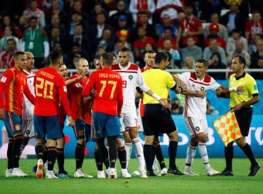 World Cup - Group B - Spain vs Morocco - Kaliningrad Stadium, Kaliningrad, Russia - June 25, 2018 Referee Ravshan Irmatov tries to separate players as Spain and Morocco clash. Reuters