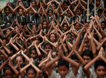School students pray for rain at a temple in Ahmedabad, India, July 19, 2018. (REUTERS/Amit Dave)
