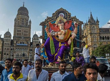 Devotees carry a Ganesha idol to be installed at a pandal ahead of Ganpati festival, in Mumbai, Saturday, Sept 8, 2018. PTI Photo