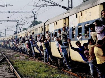People travel by an over crowded train during the opposition parties' 'Bharat Bandh', called against the fuel price hike and devaluation of the rupee, in Patna, Monday, September 10, 2018. (PTI Photo)