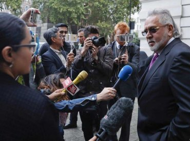 F1 Force India team boss Vijay Mallya speaks to the media outside Westminster Magistrates Court during a break for lunch as he attends a hearing at the court in London, Wednesday, Sept. 12, 2018. Investigators have accused the 62-year-old of paying $200,000 to a British firm for displaying his company Kingfisher's logo during the Formula One World Championships in London and some European countries in the 1990s. AP/PTI