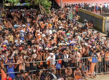 Devotees wait for opening of the Lord Ayyappa Temple in Sabarimala, Kerala. Tension was witnessed outside the temple that was opened for the first time for women of all ages on Wednesday, following a 28 September Supreme Court verdict that turned over the age-old custom of not admitting women between the age group of 10-50 years of age. PTI