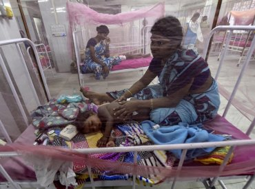 Dengue-affected children receive treatments in a special ward where beds are covered with mosquito-nets, at the Institute of Child Health and Hospital (ICHH) at Egmore, Chennai, Monday. 7-year-old twins Diksha and Dakshan died of dengue fever in the hospital. PTI Photo