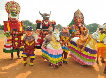 A folk troupe poses for a picture during the Kannada Rajyotsava celebrations in Mandya on Thursday. DH photo