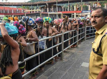 Devotees arrive at Sabarimala Temple, in Pathanamthitta District, Monday, Nov 05, 2018. This is the second time the hill temple will open for 'darshan' after the Supreme Court allowed entry of women of all age groups into it. (PTI Photo)
