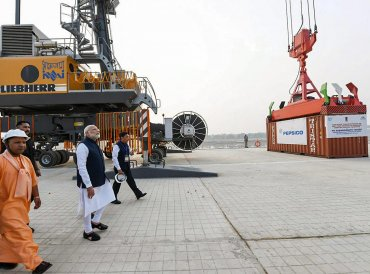 Prime Minister Narendra Modi looks on at India's first multi-modal terminal on the Ganga river during its inaugural function, in Varanasi, Monday, Nov 12, 2018. (PIB Photo via PTI)