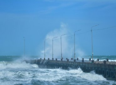 A wave hits the sea walkway after cyclonic storm 'Gaja' made landfall at Rameswaram, in Ramanathapuram district. PTI photo