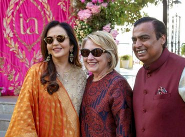 Reliance Group Chairman Mukesh Ambani and wife Nita Ambani pose for photos with former US Secretary of state Hillary Clinton as Clinton arrives to attend the pre-wedding celebration of Isha Ambani, in Udaipur, Saturday, Dec. 8, 2018. (PTI Photo)