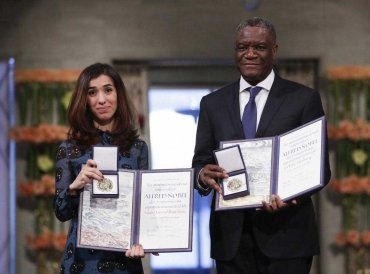 The Peace Price laureates Dr. Denis Mukwege from Congo and Nadia Murad from Iraq, left, pose with their medals during the Nobel Peace Prize Ceremony in Oslo Town Hall, Oslo, Monday Dec. 10, 2018. Dr. Denis Mukwege and Nadia Murad receive the Nobel Peace Prize recognising their efforts to end the use of sexual violence as a weapon of war and armed conflict. AP/PTI