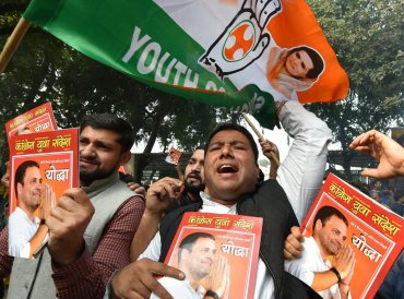 Congress party workers celebrate the party's good show in the Assembly elections of Rajasthan, Chhattisgarh and Madhya Pradesh, at AICC headquarters in New Delhi, Tuesday, Dec 11, 2018. (PTI Photo)