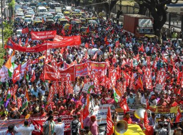 Factory workers and members of Centre of Indian Trade Unions (CITU) raise slogans during a 48-hour-long nationwide general strike called by central trade unions in protest against the