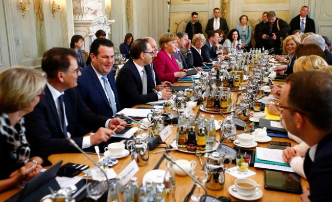 German Chancellor Angela Merkel and Ministers attend at a cabinet session during a retreat at the German government guesthouse Meseberg Palace in Meseberg, Germany. Reuters Photo