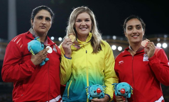 Gold medalist Dani Stevens of Australia, silver medalist Seems Punia of India and bronze medalist Navjeet Dhillon of India on the podium. (REUTERS)