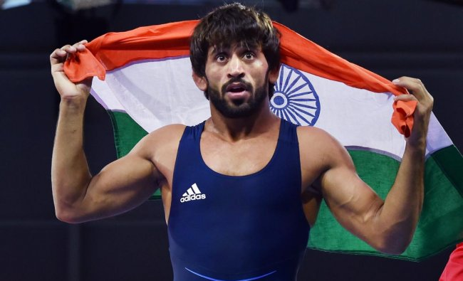 India\'s Bajrang celebrates after defeating Wales\' Kane Charig to win gold in men\'s freestyle 65 kg wrestling event, at the Commonwealth Games 2018 in Gold Coast, on Friday. (PTI Photo)