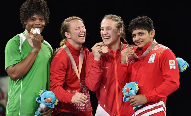 Gold medalist Erica Wiebe of Canada, silver medalist Blessing Onyebuchi of Nigeran, bronze medalists Kiran and Georgina Nelthorpe during the medal ceremony of the women's freestyle 76kg category during the Commonwealth Games 2018 in Gold Coast, on Thursday. (PTI Photo)