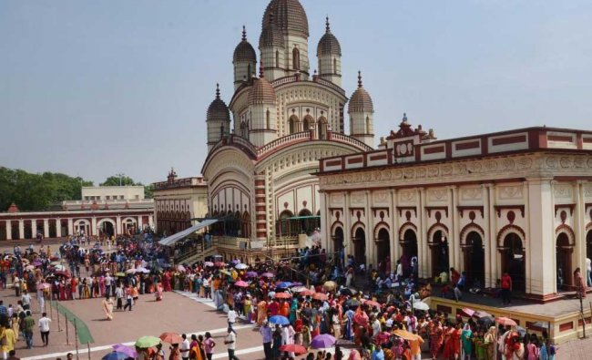 Devotees wait in long queues to offer prayers on the occasion of Bengali New Year at Dakshineswar temple, Kolkata. PTI Photo