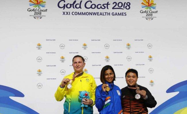 Gold medalist Heena Sidhu of India, silver medalist Elena Galiabovitch of Australia and bronze medalist Alia Sazana Azahari of Malaysia on the podium. Reuters Photo