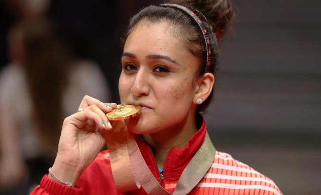 Table tennis gold medalist Manika Batra of India poses with medal. (REUTERS)