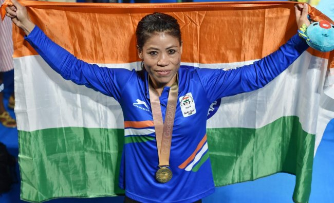 Gold medalist India\'s MC Mary Kom poses for photographs during the medal ceremony of the women\'s Light Fly (45-48kg) boxing event at the Commonwealth Games 2018 in Gold Coast, Australia on Saturday. (PTI Photo)