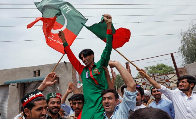Supporters of Imran Khan, chairman of the Pakistan Tehreek-e-Insaf (PTI) party, celebrate a day after the general election, in Peshawar, Pakistan. (Reuters Photo)