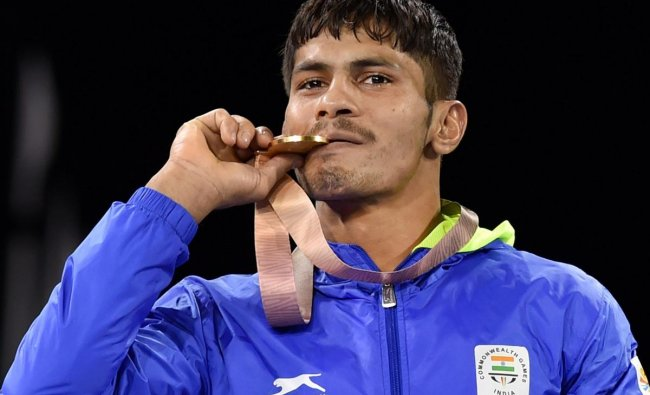 Gold medalist India\'s Rahul Aware during the medal ceremony of men\'s freestyle 57kg wrestling final at the Commonwealth Games 2018 in Gold Coast, on Thursday. (PTI Photo)