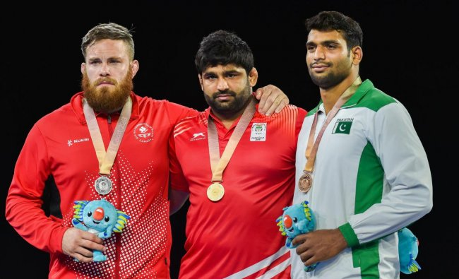 Gold medalist India\'s Sumit during the medal ceremony of MFS 125kg wrestling Nordic at the Commonwealth Games 2018 in Gold Coast, Australia on Saturday. (PTI Photo)