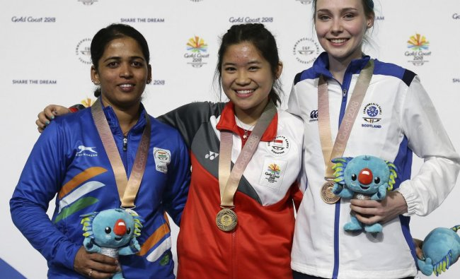 Tejaswini Sawant of India, left, silver medal, Martina Lindsay Veloso of Singapore, center, gold medal, and Seonaid McIntosh of Scotland, right, bronze medal, stand on the podium during the women\'s 50m Rifle Prone final at the Belmont Shooting Centre during the 2018 Commonwealth Games in Brisbane, Australia, Thursday, April 12, 2018. (AP/PTI Photo)