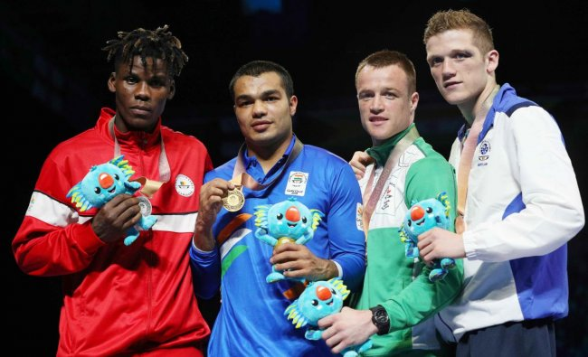 Silver medalist Dieudonne Wilfried Seyi Ntsengue of Cameroon, gold medalist Vikas Krishan of India and bronze medalists Steven Donnelly of Northern Ireland and John Docherty of Scotland pose with medals. (REUTERS)