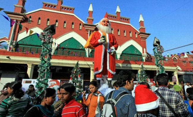People participate in a street carnival during Christmas festivities in Kolkata