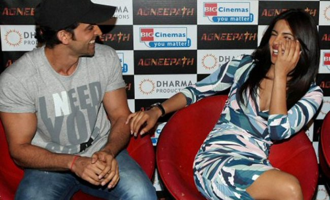 Hrithik Roshan and Priyanka Chopra share a laugh during the launch of the trailer of their new film