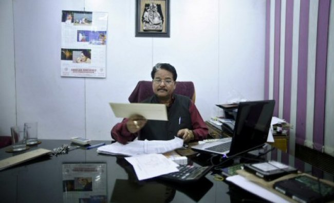 Dalit enterpreneur Hari Kishan Pippal sits for a photograph..