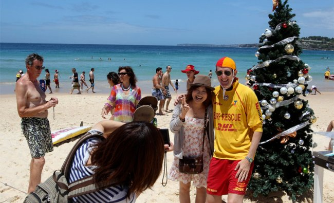 Beachgoers enjoying Christmas at Bondi Beach in Sydney