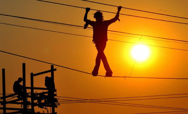 Power department staff maintain electrical cables in Allahabad ahead of magh mela