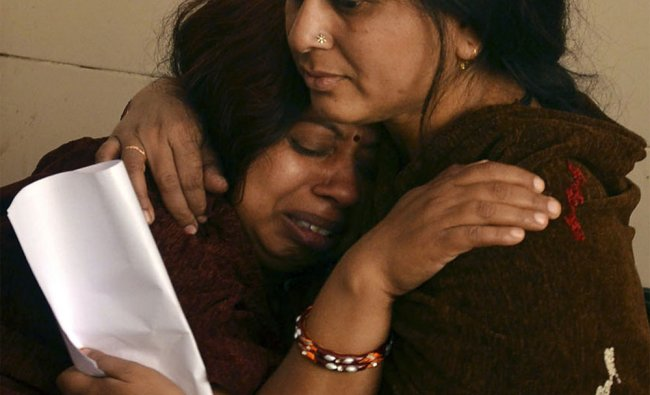 Relatives of children who died in a bus accident near Indore