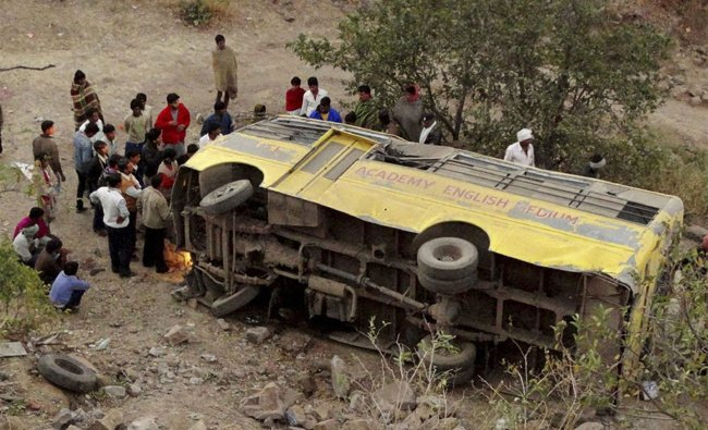 A school bus is seen after falling into a gorge near Indore
