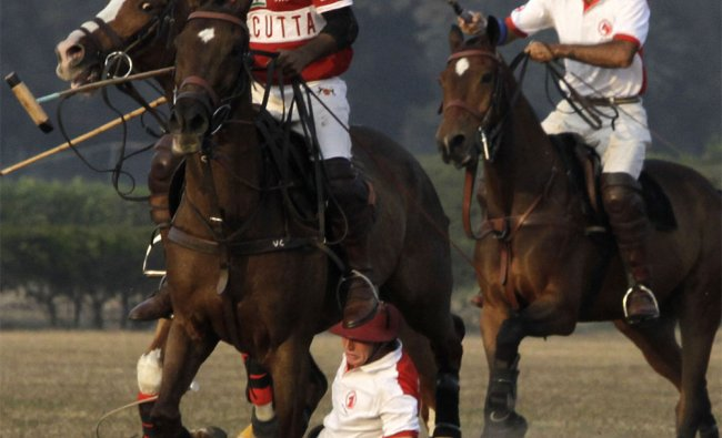 A Rest of the World player falls from his horse during Ezra World Masters Challenge Cup