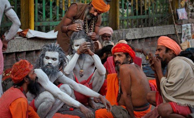 A group of sadhus siting at Babughat camp in Kolkata