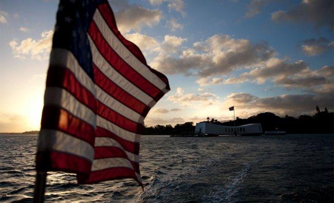 The USS Arizona Memorial in Pearl Harbour is seen in the distance